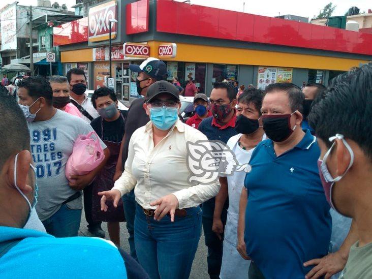 Locatarios del Mercado Morelos reabren circulación de avenida Hidalgo